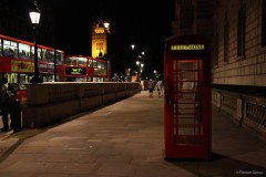 Red telephone boxes and buses, London