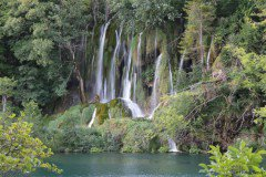 Waterfall in Plitvice and a lake